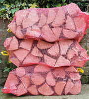 Netted Sacks Logs Netted Bagged Logs Petersfield Logs & Coal Firewood Bulk Bags Logs Sheet Liss Hawkley Rake Milland Rogate Nyewood Froxfield Langrish Harting Buriton Liphook